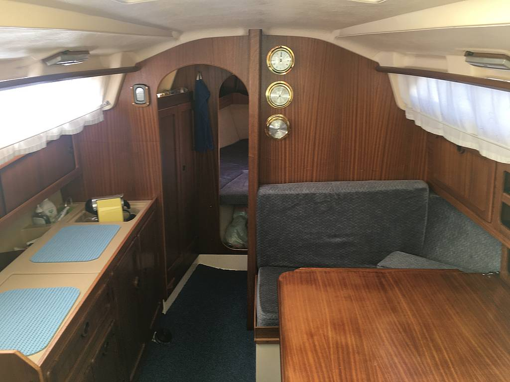 Kitchen and sitting area in a sailing yacht